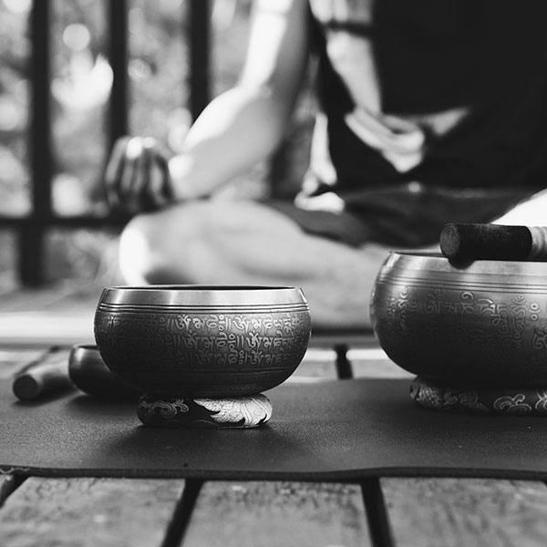 meditating with Tibetan singing bowls
